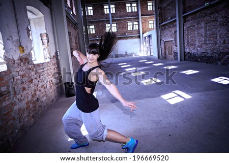 woman in sport dress dancing fitness dance or aerobics