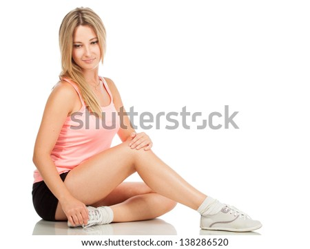 woman in sports clothes isolated on white