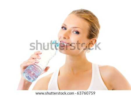 Woman in sportswear drinking water, isolated on white - stock photo