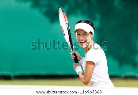 Woman in sportswear plays tennis at contest - stock photo