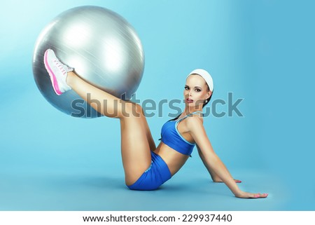 Woman in Sportswear with Fitness Ball. Training. Athletics - stock photo
