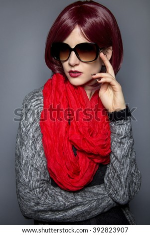 Woman in spring or fall fashion wearing retro style sun glasses