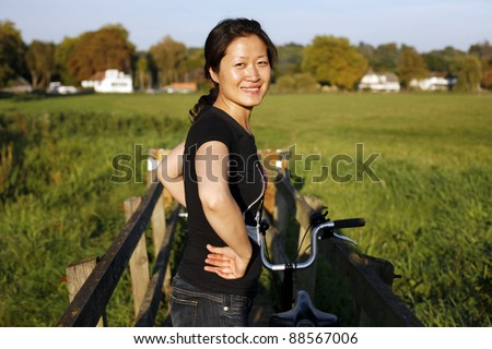 Woman in suburb cycling around Windsor