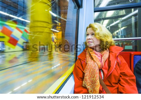 woman in subway by night - stock photo