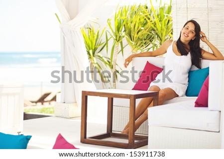 woman in summer - relaxing in villa - stock photo
