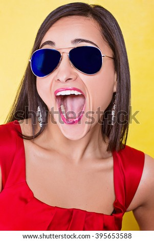 Woman in sun glasses screaming