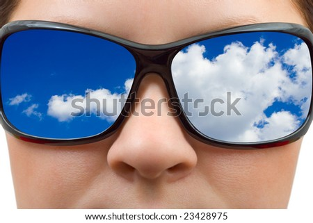 Woman in sunglasses and sky reflection isolated on white background - stock photo
