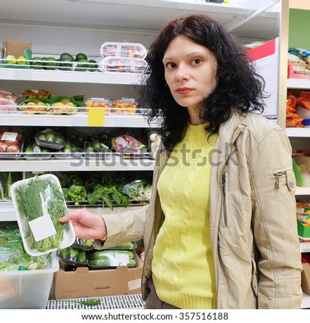 Woman in supermarket - stock photo