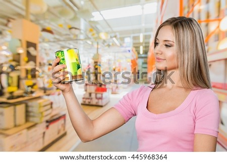 Woman in supermarket. - stock photo