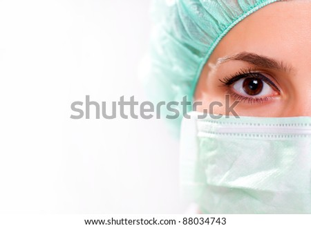 Woman in surgical mask - stock photo