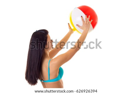 Woman in swimming suit with ball