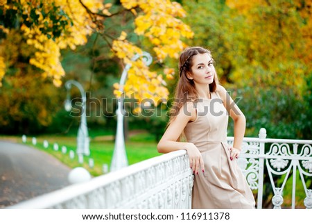 Woman in the autumn park - stock photo