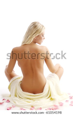 Woman in the bath towel on white background