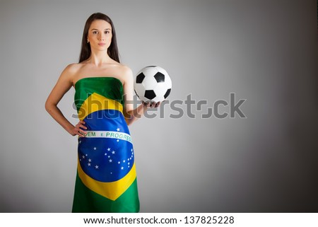 woman in the Brazilian flag on the gray background - stock photo