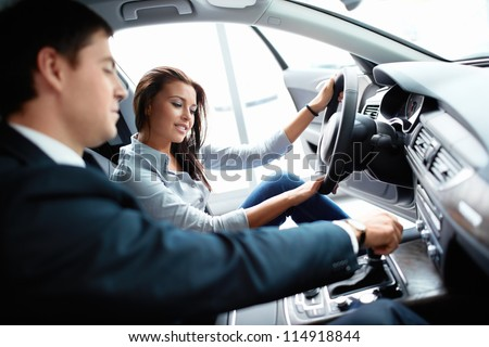 Woman in the car and seller - stock photo