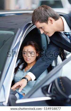 Woman in the car at a showroom