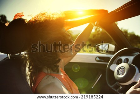 woman in the car. cabriolet