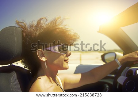 Woman in the car. driving pleasure