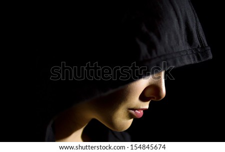 Woman in the dark - stock photo