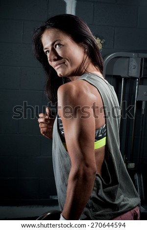 Woman in the gym - stock photo
