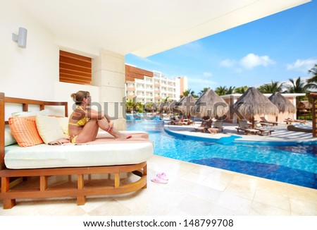 Woman in the hat on vacation. Tropical resort. - stock photo