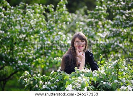 Woman in the lush spring garden - stock photo