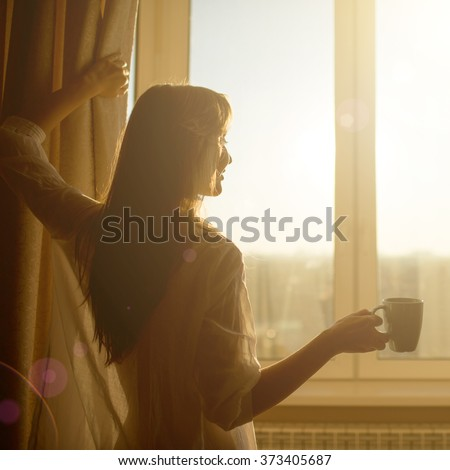 stock photo woman in the morning attractive sexy woman with neat body is holding a cup with hot tea or coffee 373405687