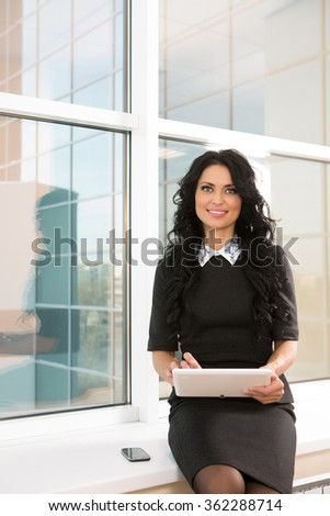 woman in the office at the computer negotiates with business partners - stock photo