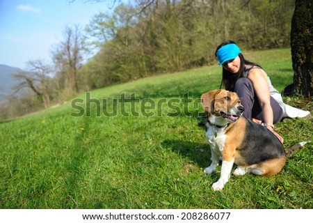woman in the park stroking her dog