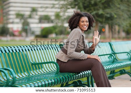 Woman in the park waving