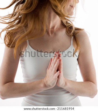 woman in the prayer position - stock photo