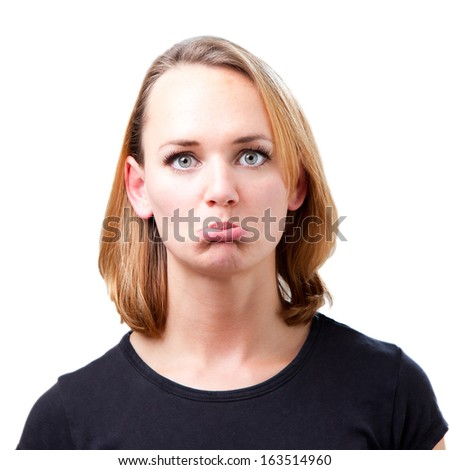 Woman in the studio clearly upset by something - stock photo