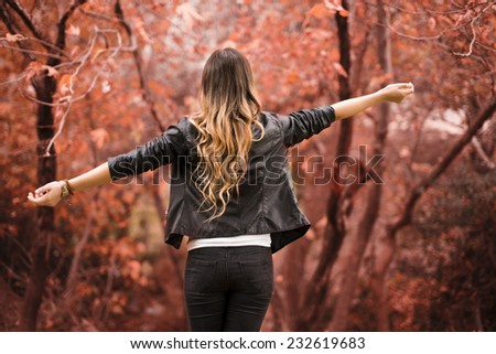 Woman in the woods. Enjoying autumn colors.