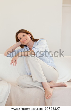 Woman in thoughts on her sofa