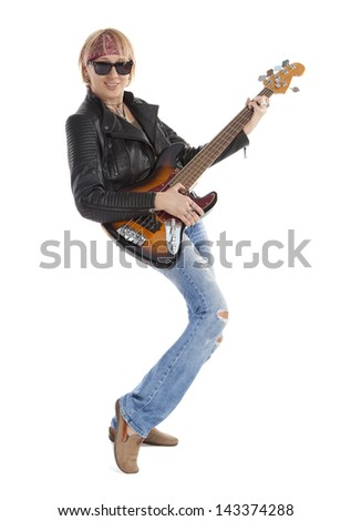 Woman in torn jeans playing guitar, looking at camera.  Isolated on white