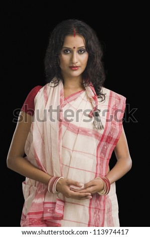 Woman in traditional Bengali dress