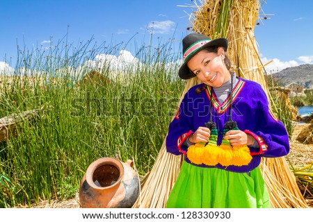 Woman in traditional indian clothing in uros, Titicaca lake Peru - stock photo