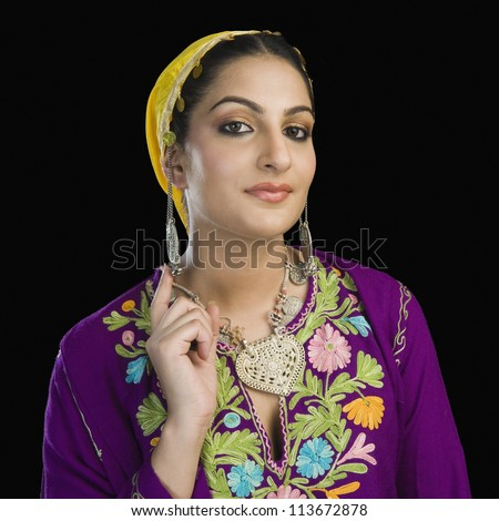 Woman in traditional Kashmiri dress gesturing