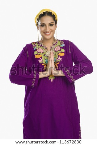 Woman in traditional Kashmiri dress greeting - stock photo