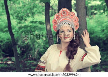 Woman in traditional Russian (slavic) costume - stock photo