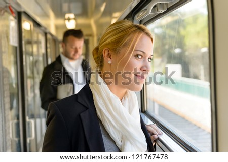Woman in train looking pensive on window smiling travel commuting
