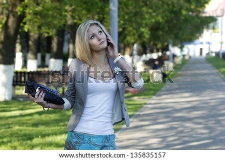woman in trendy dress is walking on street