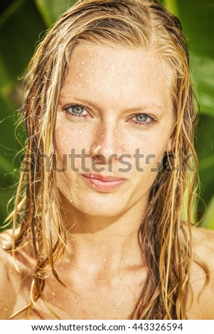 woman in tropical shower in the summertime