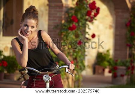 Woman in Tuscany garden - stock photo