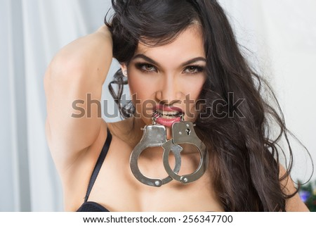 Woman in underwear, bite handcuffs, bdsm, sex toy - stock photo