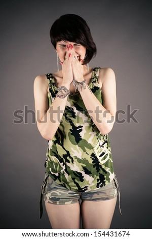 woman in uniform sneezes - stock photo