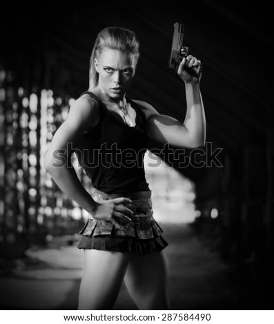 Woman in uniform with gun (monochrome version)