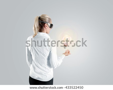 Woman in virtual reality glasses looking to the hologram, isolated, clipping path. Shirt person stand back looking 3d cyber headset display. Wearable vr computer head set goggles watching. Man glasses - stock photo