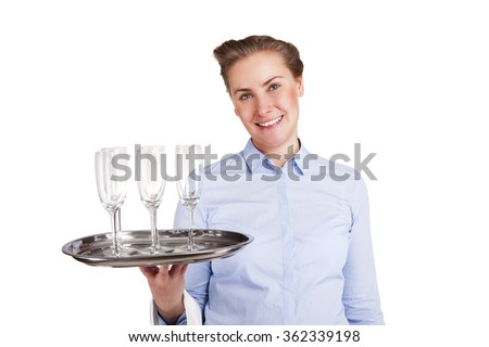 Woman in waiter uniform holding tray with glasses, smiling, isolated, white background. - stock photo