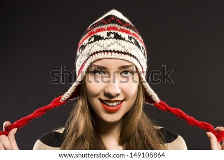 woman in warm hat. studio black background - stock photo
